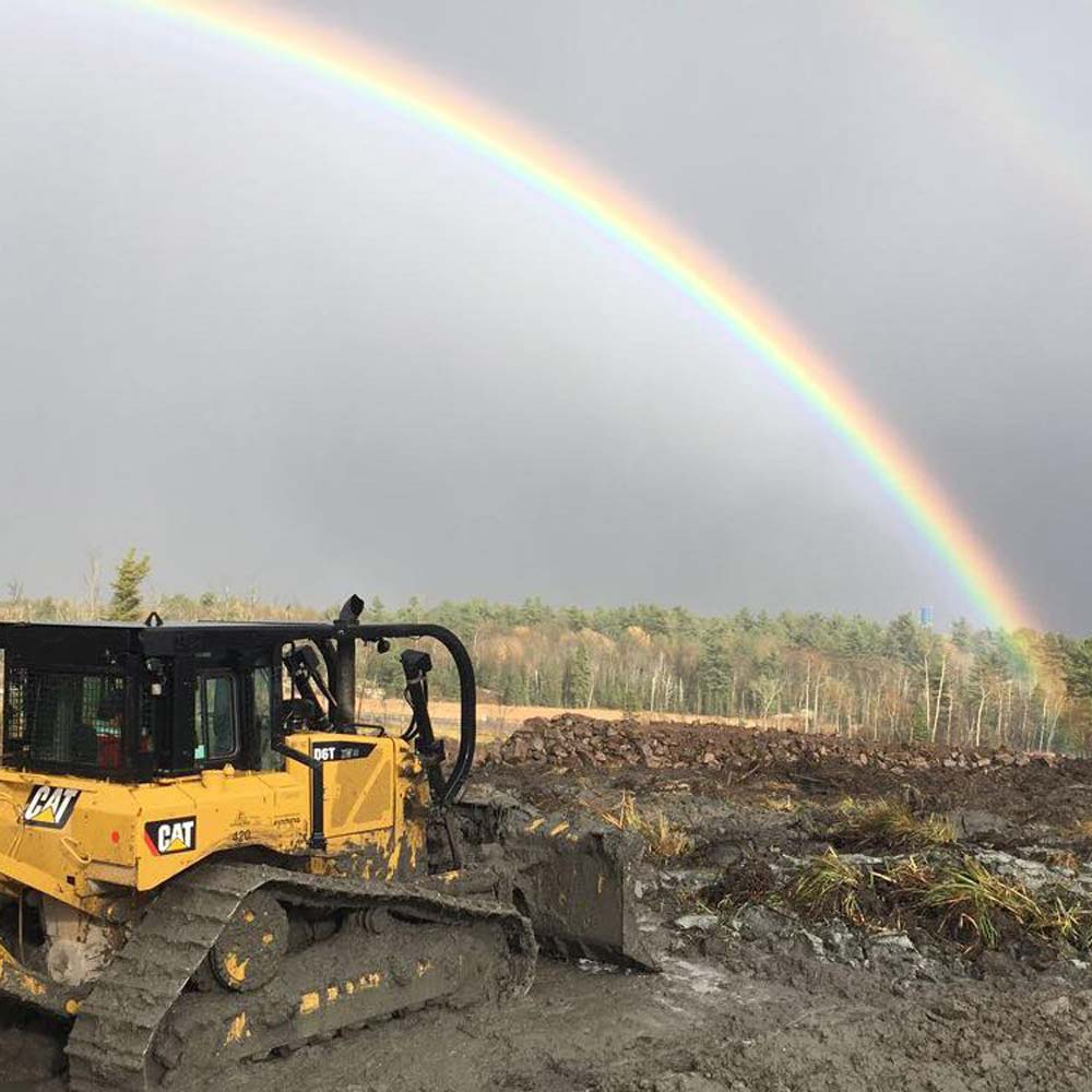 highway construction with rainbow in background