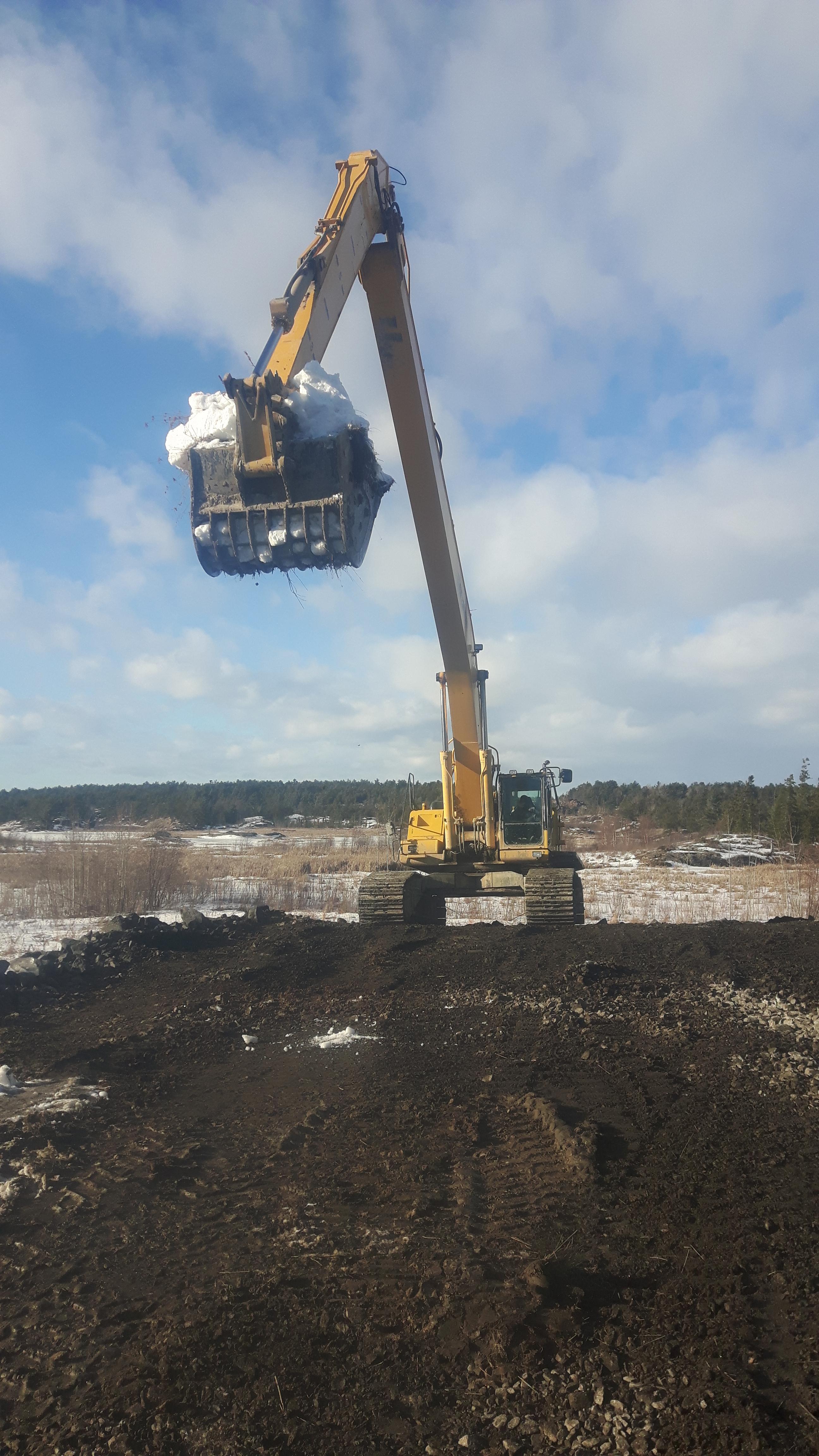 large excavator preparing construction site