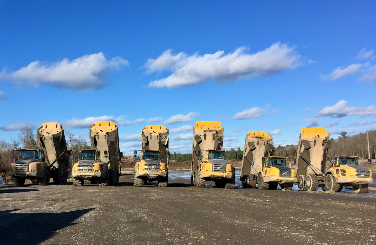 fleet of rental dumptrucks