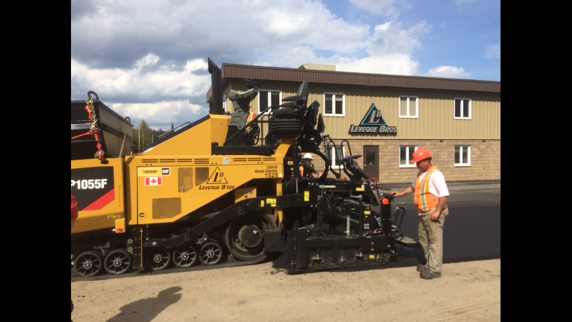 asphalt paving machine with operator