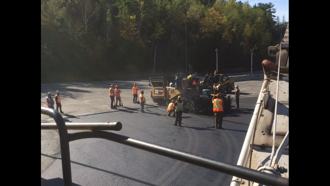 large asphalt paving team finishing road