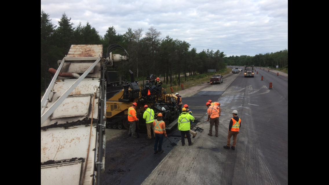 asphalt paving crew paving highway