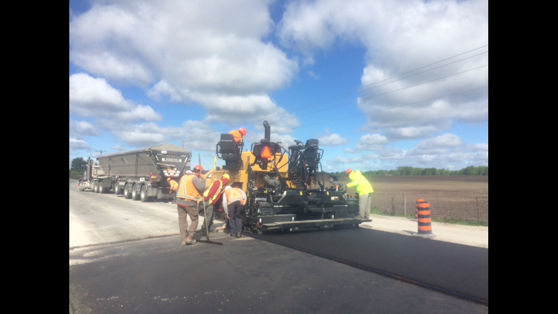 crew paving highway with asphalt
