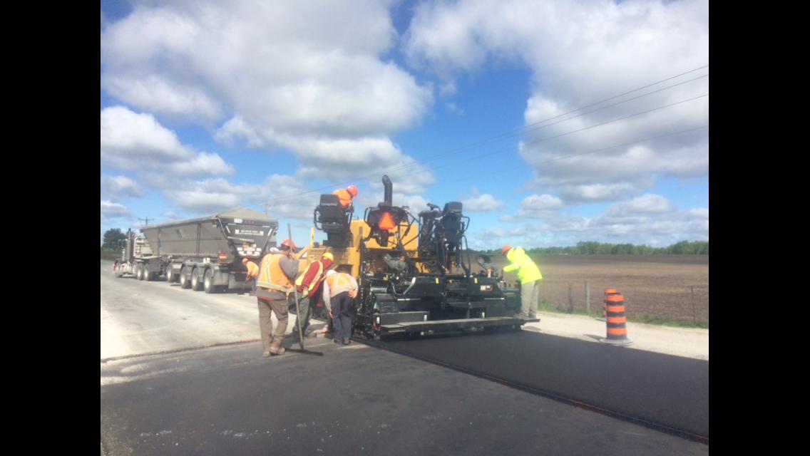 crew paving highway with asphalt